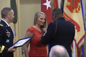 A Ft. Stewart volunteer receiving a award