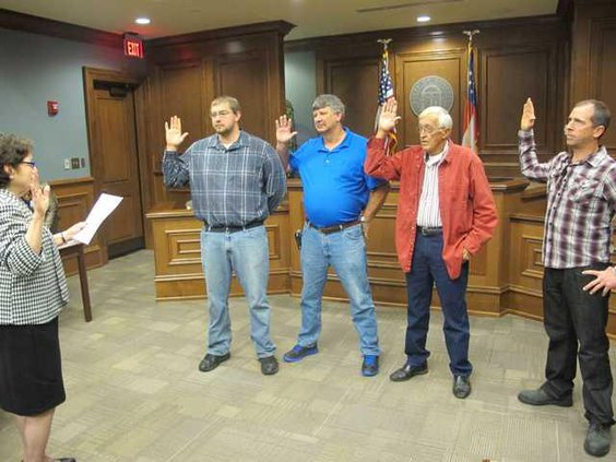 Liberty County Probate Judge Nancy Aspinwall officiates the swearing-in ceremony for Gum Branch City Council members left to right Jesse Stickland Richard Strickland Jim Chandler and Charles Simpson