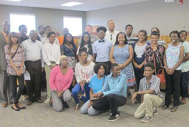 The youth participants and coordinators of the Career Readiness program gather together for a photo with the Liberty County Board of Commissioners