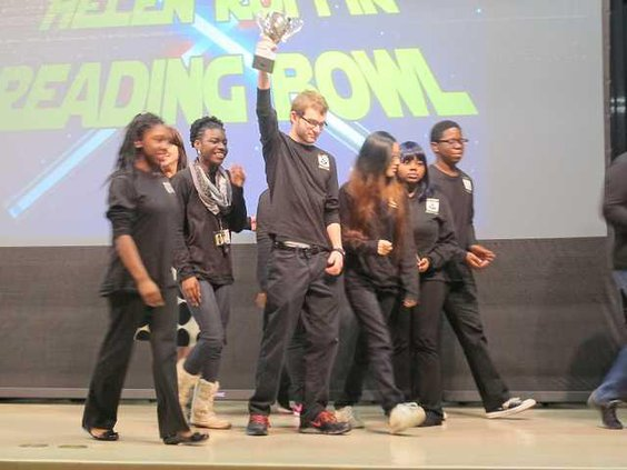 As the reading bowl team from Liberty County High School leaves the stage after winning second place senior Clayton Grant raises up the teams trophy
