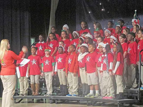 The Taylors Creek Elementary School chorus sings Jingle Bell Rock for an audience of parents family and other community members at the Holiday Extravaganza
