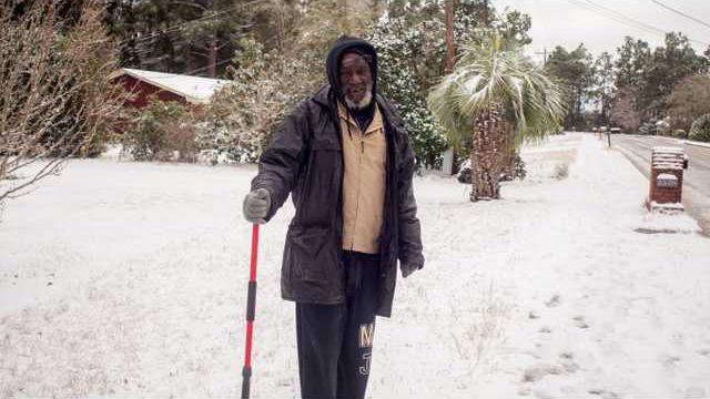 lpd08463Local resident Frank Lesueur venturing out after the storm
