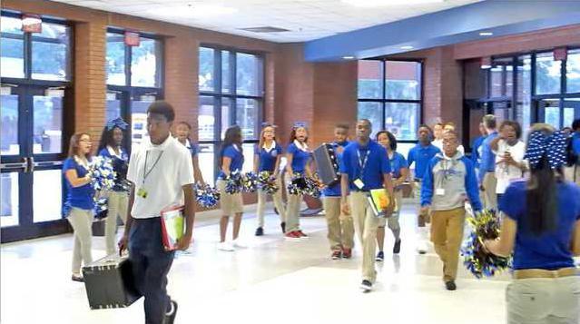 Bradwell Institute cheerleaders greeting students