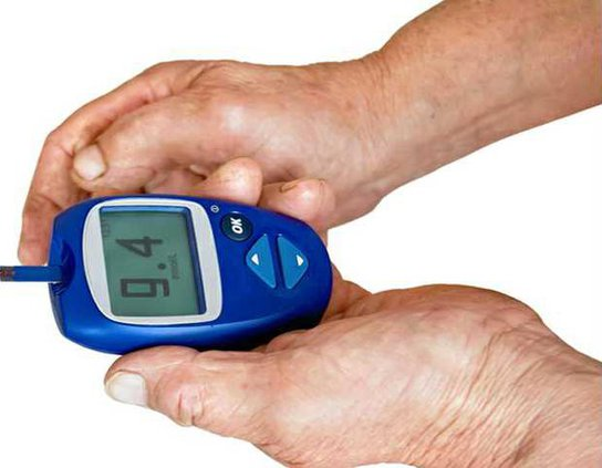 glucometer in the hands of
