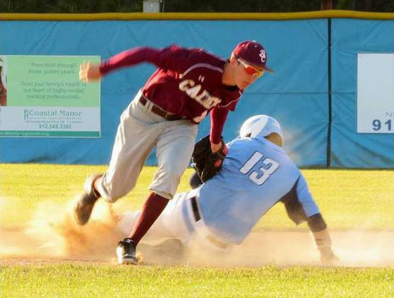 13 Luke Golden slides into first against the Cadets.