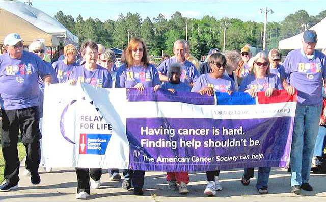 2 Wed 5-6 Survivors take fist lap at Long Co Relay for  Life