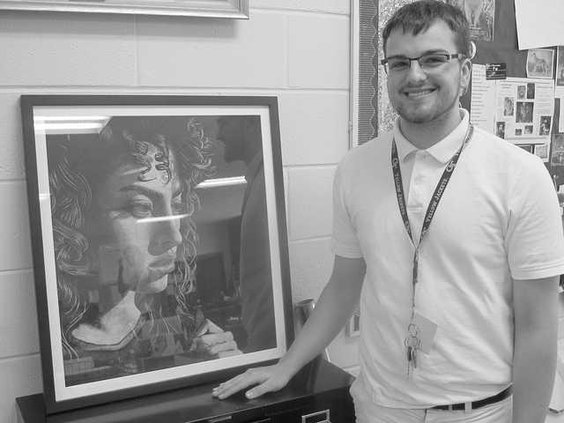 Bradwell Institute Senior Caleb Sanker stands next to his artwork done with charcoalthat was submitted to an exhibition where the winner will have their work displayed in Washington DC