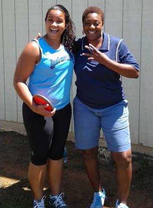 Sr. Kicha May and track coach Erica Harris