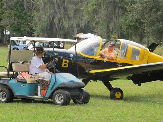 Berg greeting pilot after landing