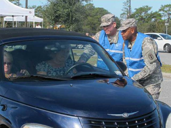 Maj. Mark Potter and Sfc. Luis Rivera OIC and NCOIC of drive-thru flu clinic