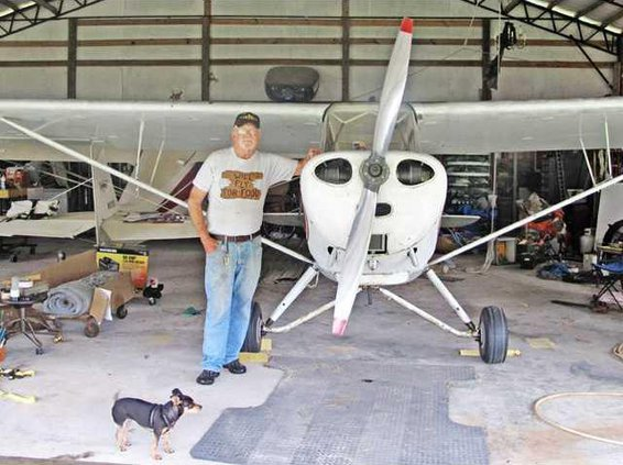 Berg standing with one of his aircraft