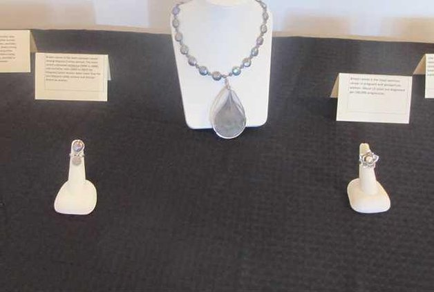 jewelry display with breast cancer awareness cards