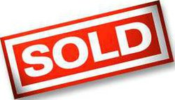 sold sign red