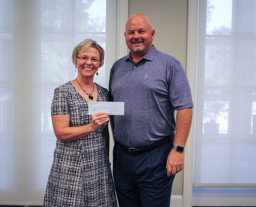 Rotary club check to family promise