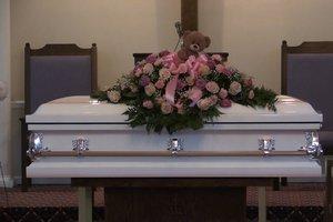Twin toddler funeral still