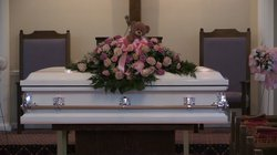 Twin toddler funeral still